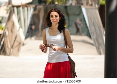 Attractive brunette, looking in frame. Portrait, Prague, May 28, 2017, near the monument to Hlava Franze Kafka. - Shutterstock ID 711556909