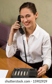 Attractive brunette on an office telephone