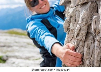 Attractive brunette rock climbing.
