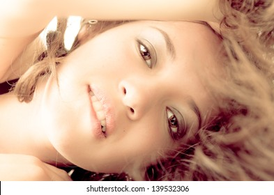 Attractive brunette woman biting her lips color processed