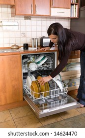 attractive brunette woman cleaning kitchen