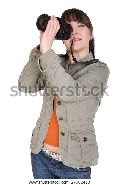attractive brunette woman with digital camera. over white background