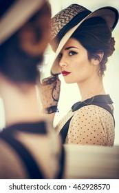 attractive brunette woman in an elegant black dress