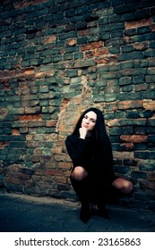 attractive brunette woman with grunge wall