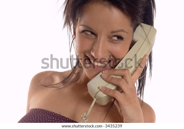 Attractive brunette woman making a call phone