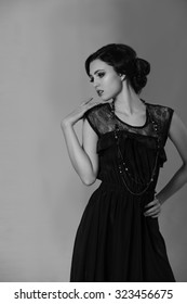 Attractive brunette woman resembling Coco Chanel