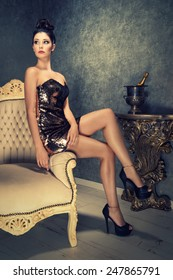 attractive brunette woman in a short golden sequined cocktail dress