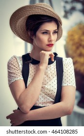 attractive brunette woman with straw hat and retro style