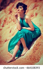 attractive brunette woman in a turquoise summer dress