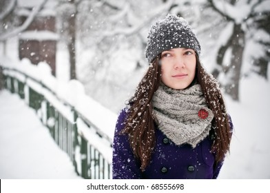 Attractive brunette young woman on snowy day