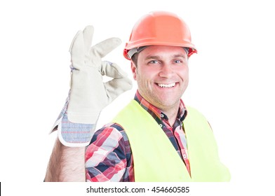 Attractive builder doing ok or perfect gesture as great construction services concept isolated on white