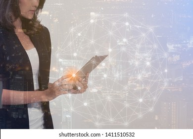 Attractive business lady working on tablet and high tech in city background