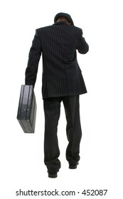 Attractive Business Man In Pin Striped Suit & Hat. Full body shot walking with briefcase away from camera.