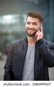 Attractive business man is talking on his smart phone