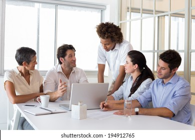 Attractive business people working hard and discussing at a business meeting