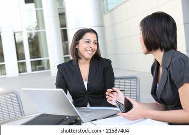 An attractive business team meeting at office on laptop computer