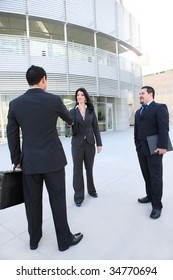 An attractive business team meeting at office building shaking hands