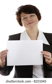 attractive business woman holding a blank paper in front of her