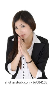Attractive business woman praying over white background.
