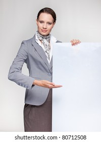 Attractive business woman  showing a board
