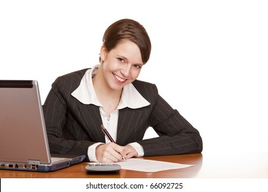 Attractive business woman sitting in office and signing contract. Isolated on white background.
