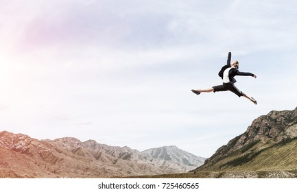 Attractive business woman in suit jumping in the air as symbol of active life position. Skyscape with sunlight and nature view on background. 3D rendering.