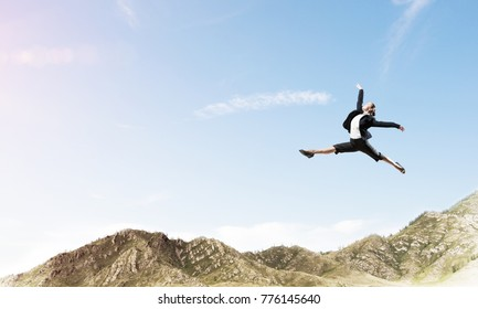 Attractive business woman in suit jumping in the air as symbol of active life position. Skyscape and nature view on background. 3D rendering.