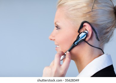 Attractive Business woman talking on a headset with copyspace and focus on the person