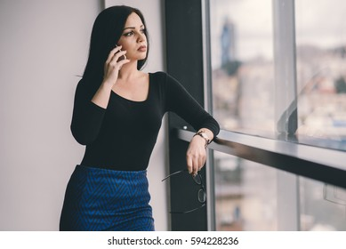 Attractive business woman talking on phone