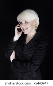 Attractive business woman talking on mobile phone