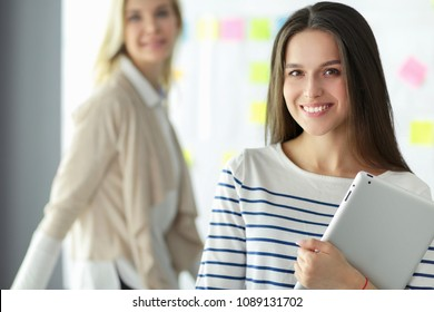 Attractive business woman working at office. Business people