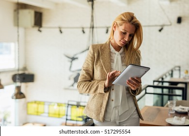 Attractive business woman working on a tablet