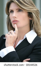 Attractive business woman is worried, thinking about a problem, suitable for economic and financial crisis theme.