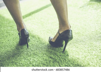 Attractive business women got Ankle sprain from walk on high heels too long.
