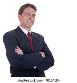 Attractive businessman with arms crossed, smiling and looking into space.