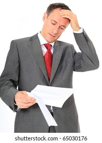 Attractive businessman gets bad news. All on white background