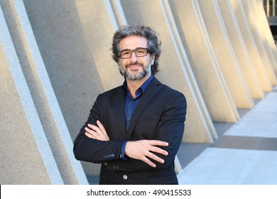 Attractive businessman with glasses portrait posing with successful expression CEO or head of company