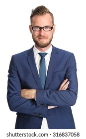 Attractive businessman standing in a blue suit and tie, wearing glasses. White background.