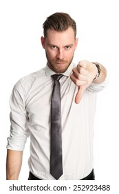 An attractive businessman standing wearing a white shirt and grey tie, doing thumbs down. White background.