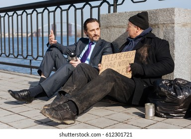 Attractive businessman telling his story to homeless