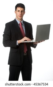 An attractive businessman using his laptop against white background