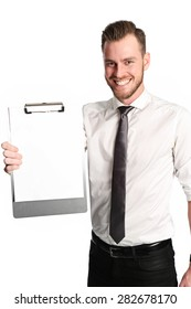 An attractive businessman wearing a wihte shirt and grey tie, standing against a white background holding a clipboard.