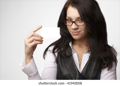 Attractive businesswoman with bussines card