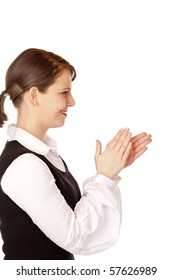 Attractive businesswoman claps with hands. Isolated on white background.