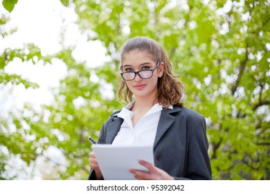 Attractive businesswoman with dairy outdoor