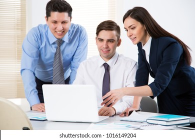 Attractive businesswoman explains to businessmen a new project