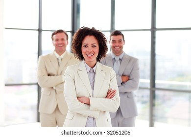 Attractive businesswoman with folded arms in office