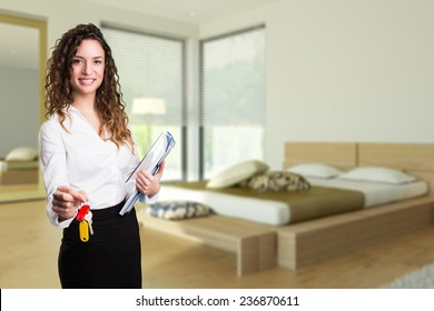 attractive businesswoman handing over keys to an apartment