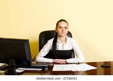 attractive businesswoman at her desk