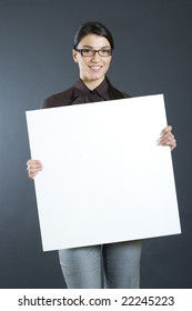 attractive businesswoman holding a blank board